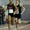 Marblehead: Marblehead junior Janaya Randall, left, and sophomore teammate Anna Barel, right, compete in the girls mile race. Randall pulled away and went onto win the mile. David Le/The Salem News