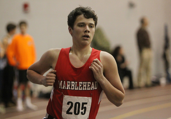 Marblehead: Marblehead senior Will Pratt comfortably cruises to a victory in the mile against Winthrop. David Le/The Salem News