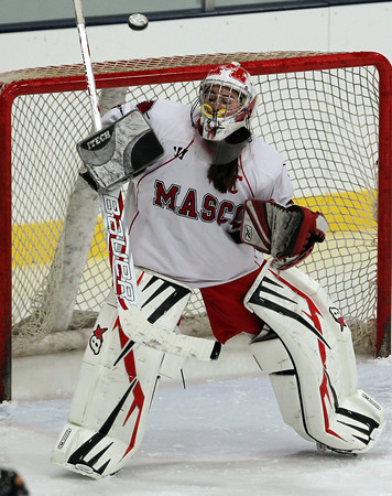Gloucester: Masco senior goalie Alex Jones reaches up with her blocker pad to make a stop on a Beverly wrist shot on Saturday evening. Jones played well between the pipes for the Chieftans, but Masconomet fell to the Panthers 2-0. David Le/The Salem News