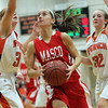 Masco junior captain Hannah Kiernan, center, splits Ipswich senior forwards Brigid O'Flynn, left, and Julia Davis, right, and goes in for a layup. David Le/Staff Photo
