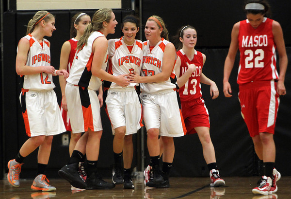 Ipswich sophomore Masey Zegarowski, center, is congratulated by teammates Caroline Soucy, left, Julia Davis, second from left, and Brigid O'Flynn, right, after Zegarowski converted a layup and got fouled in the process. Zegarowski led the Tigers with 17 points and Ipswich defeated Masco 57-40 on Thursday evening. David Le/Staff Photo