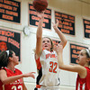 Ipswich senior forward Julia Davis, center, hits a jump shot between Masco senior Claudia Marsh, left, and junior Hannah Kiernan, right, on Thursday evening. David Le/Staff Photo
