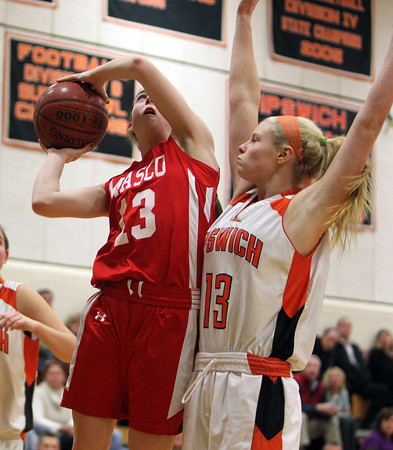Masco sophomore Kate Kitsakos, left, goes up for a layup while being fouled by Ipswich sophomore Jordan Morrissey, right, on Thursday evening. David Le/Staff Photo