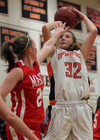 Ipswich senior captain Julia Davis hits a jump shot with Masco junior Lexie Nason right in her face during the first quarter of play on Thursday evening. David Le/Staff Photo