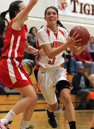 Ipswich sophomore guard Masey Zegarowski, right, drives into the lane and hits a layup while being defended by Masco sophomore Meghan Collins, left. David Le/Staff Photo