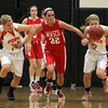Masco senior captain Claudia Marsh, center, battles for a loose ball with Ipswich senior captain Brigid O'Flynn, left, and sophomore Caroline Soucy, during the second half of play on Thursday evening. David Le/Staff Photo