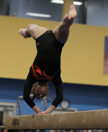 Beverly: Beverly sophomore Heather Gomes does a backwards flip on the beam on Thursday evening. David Le/Salem News