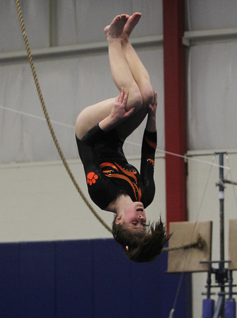 Beverly: Beverly junior Tatum Geary flips upside-down during her floor routine during a quad-meet on Thursday evening at the Sterling YMCA. David Le/Salem News