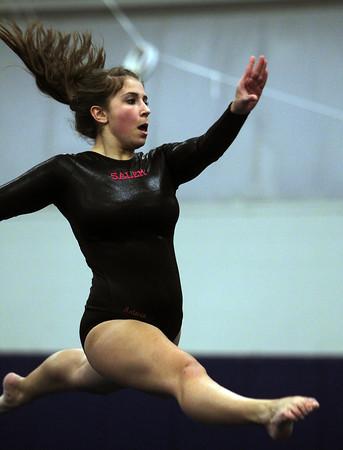 Beverly: Salem High School junior Antonia Katsiris leaps high in the air in a split during her floor routine on Thursday evening. David Le/Salem News