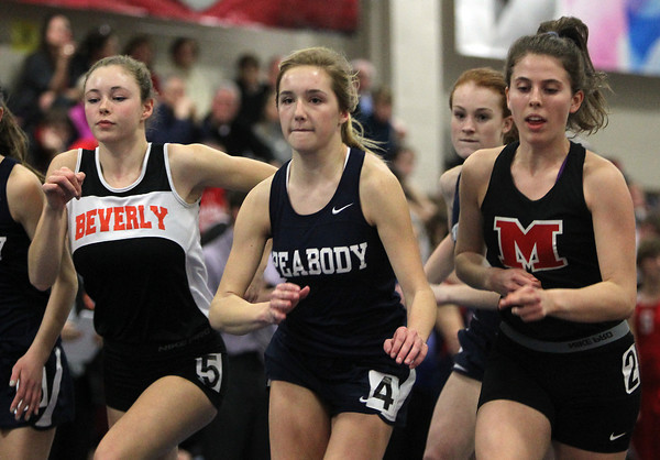 Boston: Peabody High School sophomore Lauren Barrett, center, jostles for position with Beverly junior Keely Higgins, left, and Marblehead junior Paige Ferrucci, right, at the start of the 1000 during the NEC Indoor Track Championships at the Reggie Lewis Center in Boston. David Le/Salem News