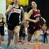 Boston: Beverly High School junior Caitlin Harty, left, out-kicks Gloucester senior Bianca Giacalone, in the homestretch of the 300 meter race at the NEC Indoor Track Championships at the Reggie Lewis Center in Boston. David Le/Salem News