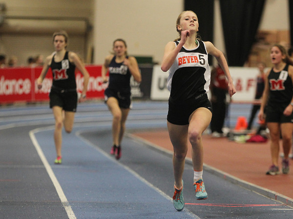 Boston: Beverly junior Jess Goodall sprints to the finish line ahead of two competitors during the finish of the girls mile at the NEC Indoor Track Championships at the Reggie Lewis Center in Boston. David Le/Salem News