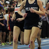 Boston: Peabody sophomore Lauren Barrett, right, and Beverly junior Nicole Demars, left, compete in the 1000m race on Thursday evening. Barrett pulled away from the other runners and took first in the 1000, helping Peabody to a team win at the NEC Indoor Track Championships at the Reggie Lewis Center in Boston. David Le/Salem News