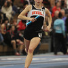 Boston: Beverly High School junior Keely Higgins runs the anchor leg of the 4x800 relay at the NEC Indoor Track Championships at the Reggie Lewis Center in Boston. David Le/Salem News