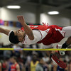 Boston: Salem High School senior Ben Sattiewhite leaps high in the air and easily clears the high jump bar during the NEC Indoor Track Championships at the Reggie Lewis Center in Boston. David Le/Salem News