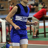 Boston: Danvers High School senior Drew Piazza cruises along a straightway during the 1000 at the NEC Indoor Track Championships at the Reggie Lewis Center in Boston. David Le/Salem News