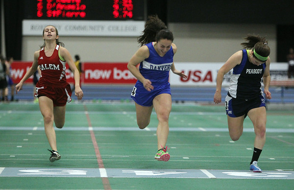 Boston: Peabody senior Hayley Dowd, right, manages to out-lean Danvers senior Xanthi Pantazelos, center, and Salem senior Joy Lima during the dash at the NEC Indoor Track Championships at the Reggie Lewis Center in Boston. David Le/Salem News