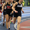 Boston: Peabody senior Catarina Rocha, right, and Marblehead junior Janaya Randall, left, compete in the two mile at the NEC Indoor Track Championships at the Reggie Lewis Center in Boston. Rocha took first for the Tanners and Randall second for the Magicians on Thursday evening. David Le/Salem News
