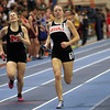 Boston: Beverly junior Keely Higgins, right, manages to hold off a late surge by Marblehead junior Paige Ferrucci, left, to win the 4x800 relay for the Panthers at the NEC Indoor Track Championships at the Reggie Lewis Center in Boston. David Le/Salem News