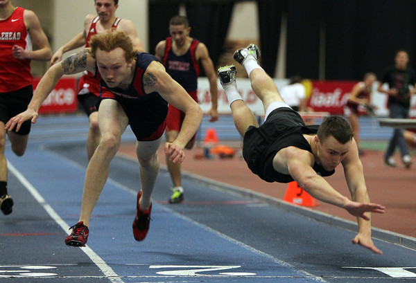 Boston: Beverly senior Brendan Flaherty, right, and Revere senior Bobby Rose, left, dive towards the finish line at the conclusion of the 300 meter race during the NEC Indoor Track Championship at the Reggie Lewis Center in Boston on Thursday afternoon. David Le/Salem News