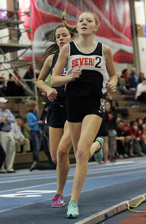 Boston: Beverly sophomore Julianna Wesley, right, leads Peabody junior Sam Allen in the girls mile race at the NEC Indoor Track Championships at the Reggie Lewis Center in Boston. David Le/Salem News