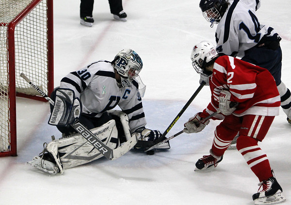 Peabody: Peabody High School senior goalie Joe Powers, left, makes a glove save on Saugus forward Nik Straticos, right, during the second period of play on Wednesday evening. David Le/Salem News