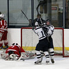 Peabody: Peabody High School forward Ryan Carney (10) congratulates senior winger Matt McIsaac, right, on his second period goal as Saugus goalie David Aiken, left, hides his face in his hands. McIsaac's unassisted goal tied the score up at 2-2. David Le/Salem News