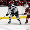 Peabody: Peabody junior defenseman Giuseppe Zarro, left, flips the puck into the offensive zone while being stick checked by Saugus sophomore Nik Straticos, right, on Wednesday afternoon. David Le/Salem News