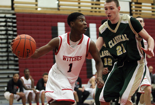 Salem: Salem High School senior guard Christian Dunston, left, looks to pass to a teammate while being defended by Lynn Classical senior Eraldo Custodio, right, on Friday evening. David Le/Salem News
