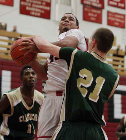 Salem: Salem High School senior forward Jared Louf-Woods, left, goes up strong to the hoop while being fouled by Lynn Classical senior Eraldo Custodio. David Le/Salem News
