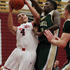 Salem: Salem High School senior Emilio Beato, left, drives to the hoop while being defended closely by Lynn Classical sophomore Phillip Rogers, right, on Friday evening. David Le/Salem News