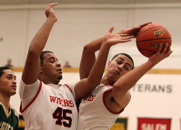 Salem: Salem High School senior forward Emilio Beato, right, grabs an offensive rebound next to teammate Jared Louf-Woods, left, during the second half of play on Friday evening. David Le/Salem News