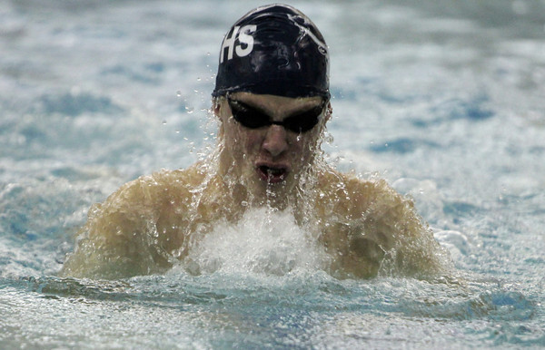 Peabody: Peabody HIgh School junior Alex Strakosha spews water as he comes up for air during the 200m Medley Relay against Salem on Tuesday evening. David Le/Salem News