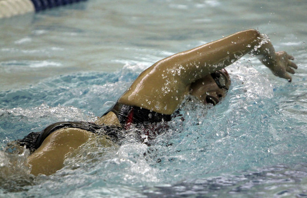Peabody: Salem High School senior Julie Nguyen comes up for air during the 200 freestyle race against Peabody on Tuesday evening. David Le/Salem News