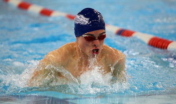 St. John's Prep junior Jake Bennett races ahead of the pack during the 100 meter breaststroke on Wednesday afternoon. David Le/Staff Photo