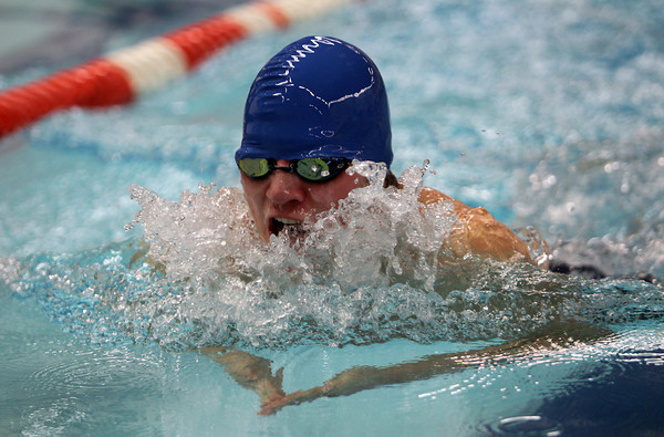 St. John's Prep senior captain Rory Colley competes in the 100 breaststroke against Catholic Memorial on Wednesday afternoon at the pool at Salem State University. David Le/Staff Photo