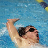 St. John's Prep senior Jimmy O'Donnell competes in the 100 meter backstroke against Catholic Memorial on Wednesday afternoon at Salem State University. David Le/Staff Photo