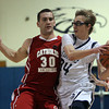 St. John's Prep senior guard Tyler Dooley, right, looks to pass around Catholic Memorial senior John McDonough, left, on Tuesday evening. David Le/The Salem News