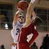 St. John's Prep senior guard Tyler Dooley, left, shoots a contested jumper over Catholic Memorial's Pat Hurley, right, during the second half of play on Tuesday evening. David Le/The Salem News