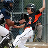 Beverly: Beverly's Ryan Barror slides safely into home plate as Hamilton-Wenham catcher Adam Parady waits for the throw. David Le/Salem News