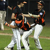 Beverly: Beverly Little Leaguers Tim McCarthy, center, and Ryan Munzing, right, rush to pick up starting pitcher John Gilbride after he struck out the last batter of the game, giving Beverly a 10-2 win over Hamilton-Wenham and their first District 15 banner in 20 years. David Le/Salem News