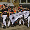 Beverly: The Beverly Little League team carries their District 15 Championship banner around the warning track giving high fives to cheering fans following their 10-2 win over Hamilton-Wenham on Friday evening. David Le/Salem News