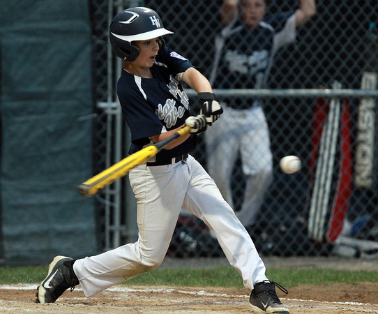 Beverly: Hamilton-Wenham's Jack Cronin connects for a single against Beverly in the District 15 Championship on Friday evening. David Le/Salem News