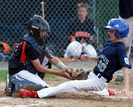 Beverly: Beverly catcher Kyle Camara applies the tag to Hamilton-Wenham center fielder Paul Horgan as he slides into home plate. David Le/Salem News