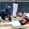 Beverly: Beverly third baseman Johnny Gilbride slides under the tag of Hamilton-Wenham catcher Phillip Durgin, left, and safely into home plate to score Beverly's second run of the game. David Le/Salem News