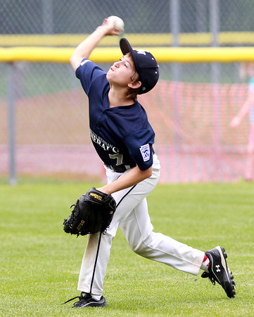 Beverly: Hamilton-Wenham right fielder Nick Glovsky uncorks a throw to try and cut down a runner advancing to third base. David Le/Salem News