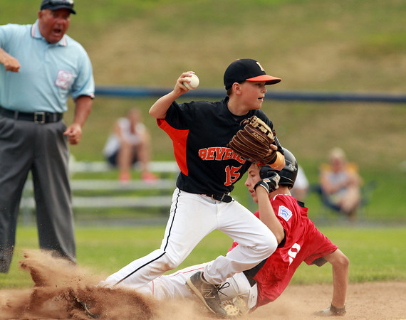 Lynn: Beverly second baseman Jack Cairns looks to fire the ball to first while getting upended by North Andover East's Steven Hajjar, after getting a force out at second. David Le/Salem News