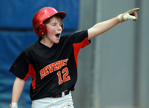 Lynn: Beverly's Matt Collins points to teammate Brayden Clark after Collins crossed the plate with the go-ahead run on a Clark double in the top of the 8th inning. David Le/Salem News