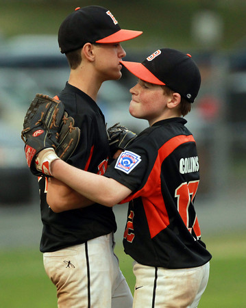 Lynn: Beverly shortstop Matt Collins (12), right, congratulates pitcher Joe Ward (24), after Beverly's thrilling 6-3 extra innings win over North Andover East. David Le/Salem News