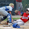 Beverly: Danvers American catcher Tom Mento tags out sliding Amesbury baserunner Dane Webber, right, as he tries to score. David Le/Salem News